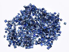 † A packet of unmounted mixed cut sapphires