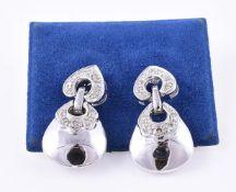 A pair of diamond drop earrings
