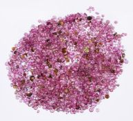 † A packet of circular cut mainly pink tourmalines