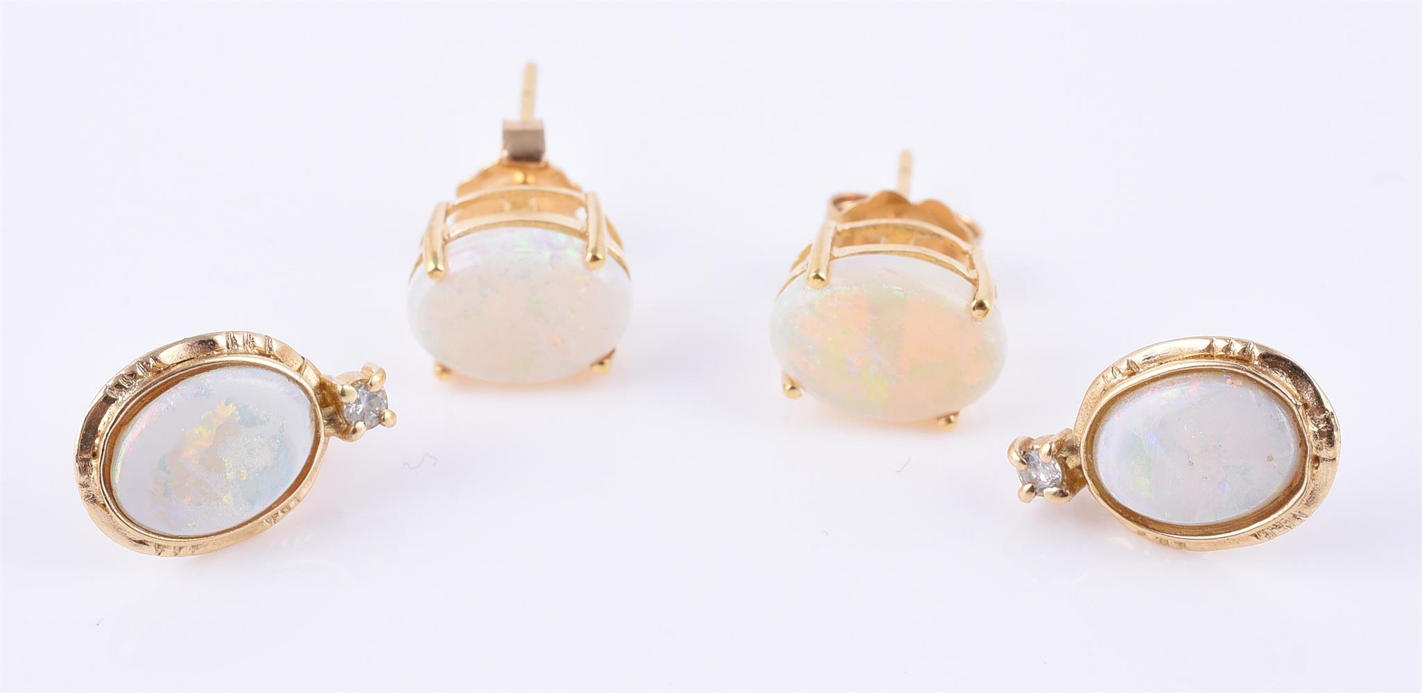 Two pairs of opal ear studs