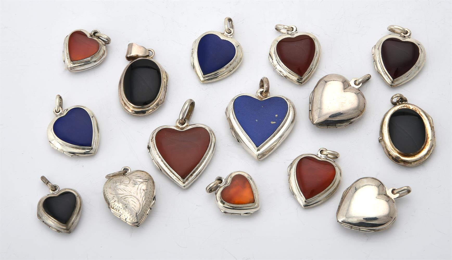 A collection of silver and silver coloured heart lockets
