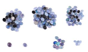 † A packet of oval cabochon opal triplets