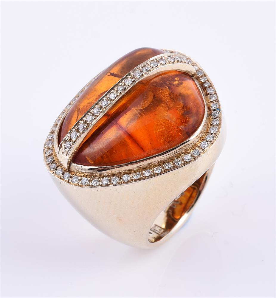 A diamond and pressed amber dress ring