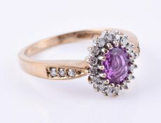 A 9 carat gold pink sapphire and diamond ring