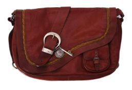 Dior, Gaucho, a red leather saddle bag