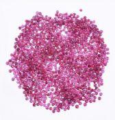 † A packet of circular cut rubies