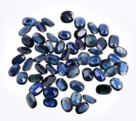 † A packet of oval cut sapphires