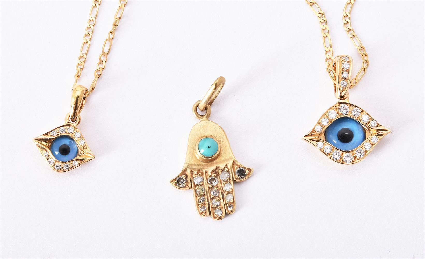 Two eye amulet pendants by Mouawad