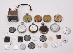 A collection of watch dials and pocket watches
