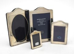 Four silver mounted shaped rectangular photo frames