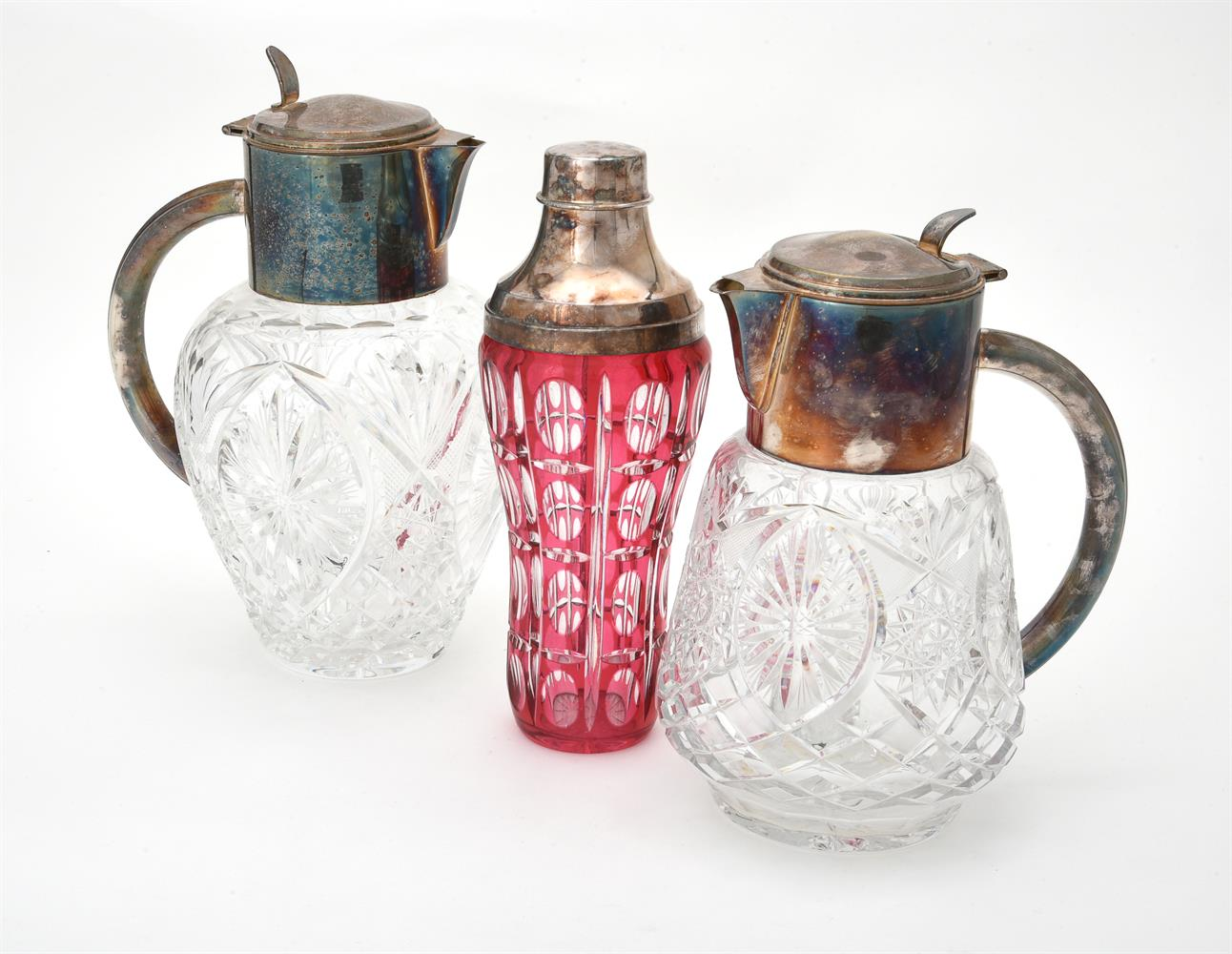 Two electro-plated mounted cut glass lemonade jugs
