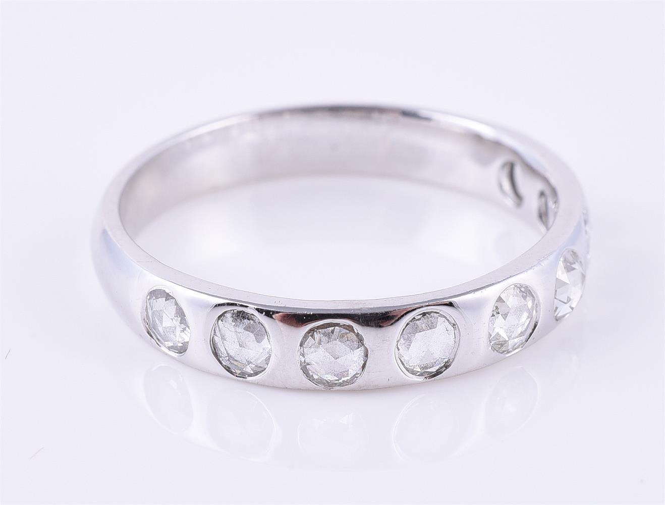 A rose cut diamond band ring