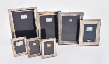 Seven silver mounted rectangular photo frames