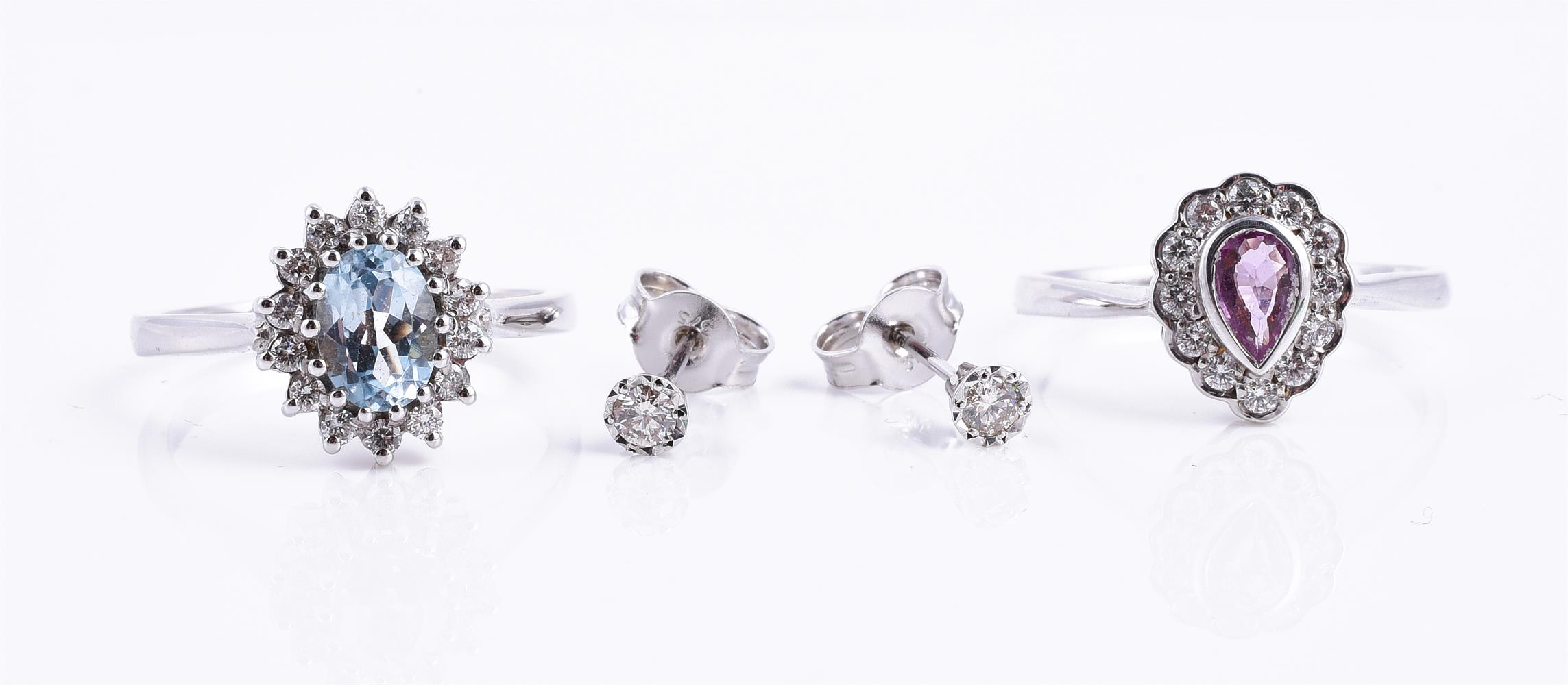 A 9 carat white gold pink sapphire and diamond pear shaped cluster ring