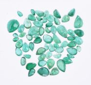† A packet of unmounted emeralds