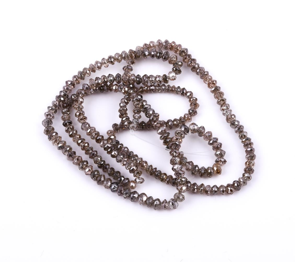 † A parcel of brown diamond beads