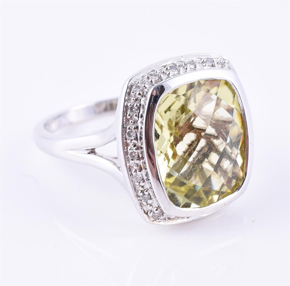 A diamond and lemon quartz cluster ring