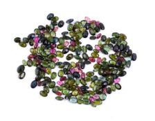 † A packet of unmounted oval cut pink and green tourmalines