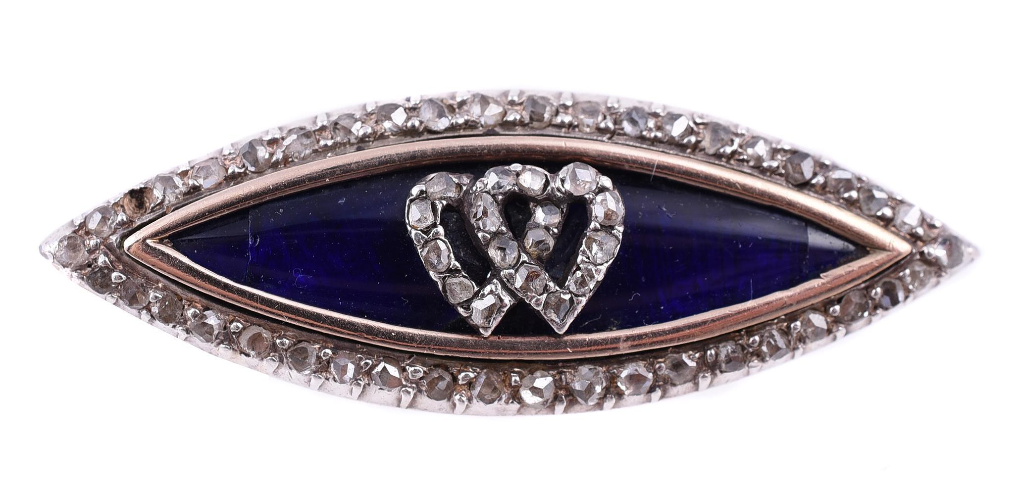 A navette shaped rose cut diamond and blue enamel brooch