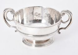 An Edwardian silver twin handled bowl by William Comyns