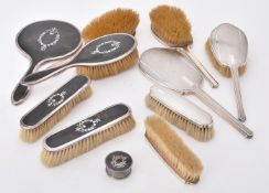 Y A silver mounted and tortoiseshell five piece dressing table set by E. S. Barnsley & Co.