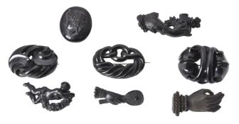 Y A collection of Victorian jet and black pressed brooches