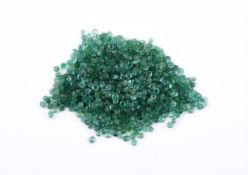† A packet of small circular emeralds