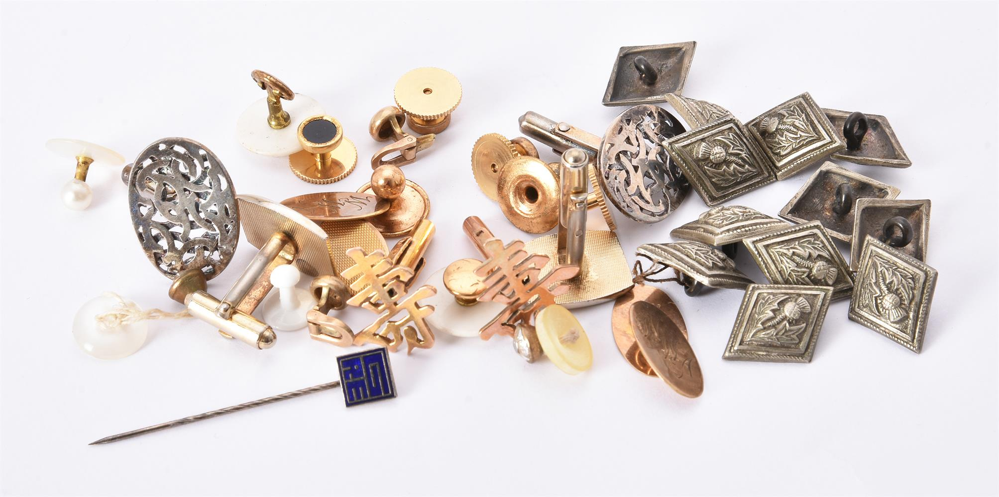 A collection of studs and cufflinks
