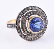 A tanzanite and diamond cluster dress ring