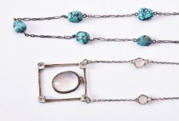An Arts and Crafts moonstone and white stone pendant necklace