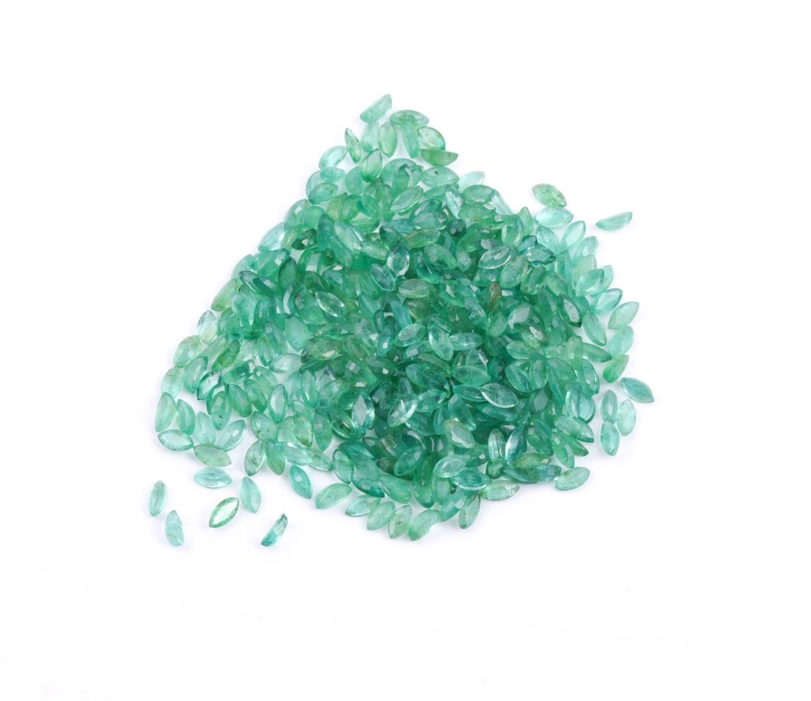 † A packet of marquise cut emeralds