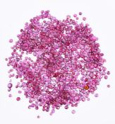 † A packet of mixed cut rubies