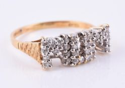 An 18 carat gold diamond MUM ring