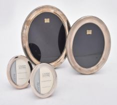 Four silver mounted oval photo frames
