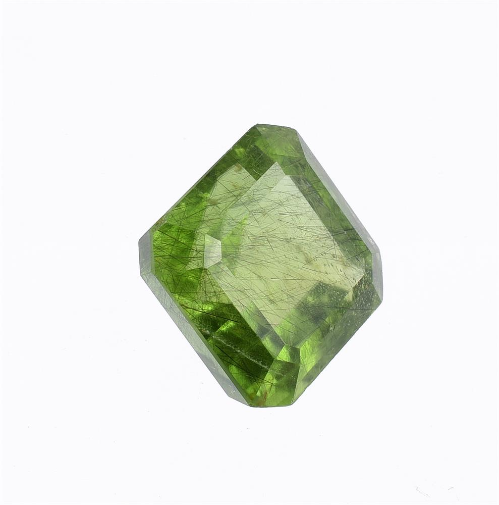 † A step cut peridot with canted corners