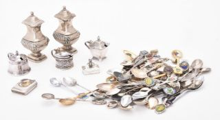 A collection of electro-plated souvenir spoons and other items