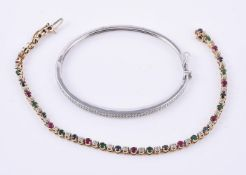 A 9 carat gold diamond hinged bangle
