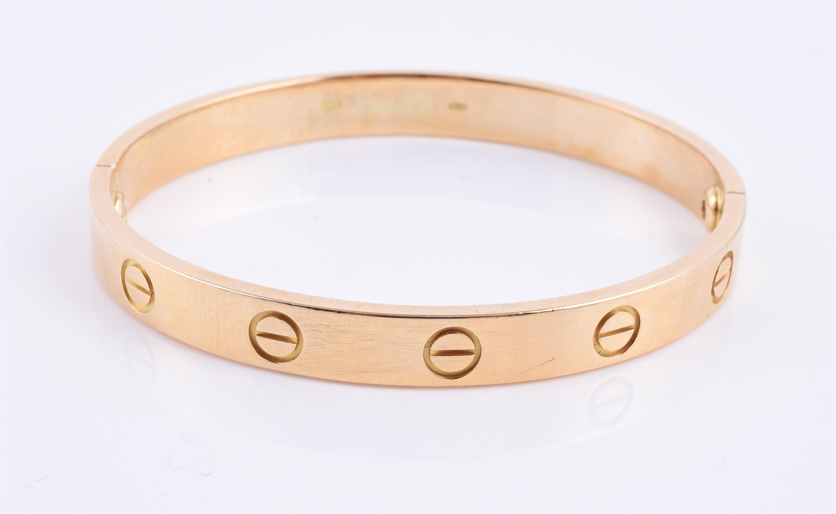 A two section gold coloured bangle