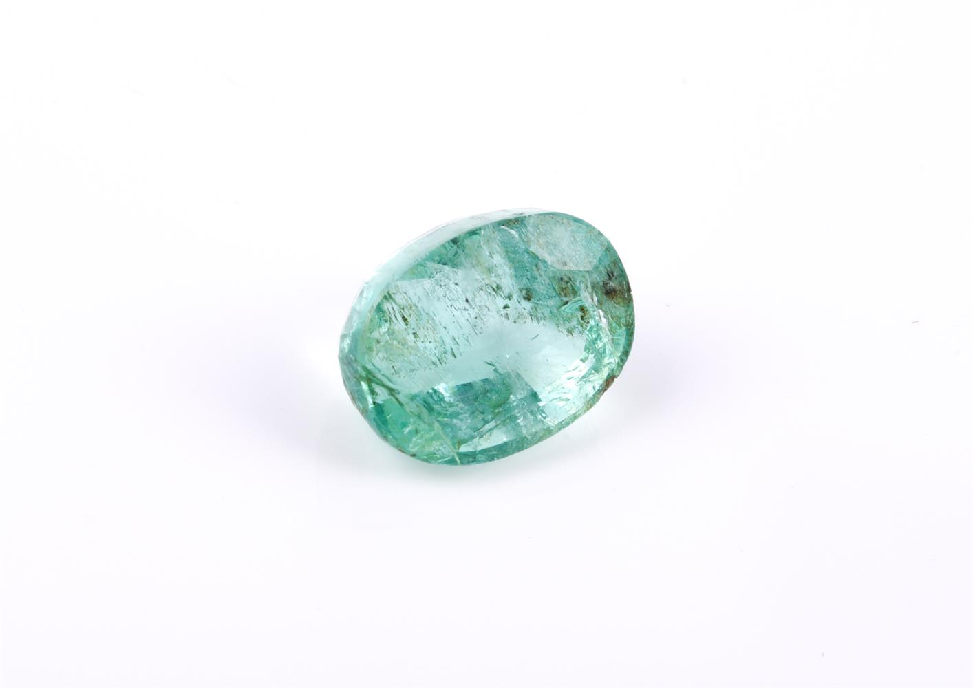 † An unmounted oval cut emerald
