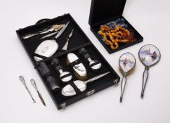 An American cased silver coloured mounted ten piece dressing table set by Saart Brothers