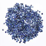 † A packet of circular cut sapphires