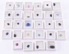 † A collection of various unmounted gemstones
