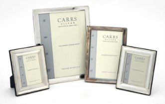 Four silver mounted rectangular photo frames by Carr's of Sheffield Ltd.