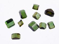 † A packet of step cut green tourmalines