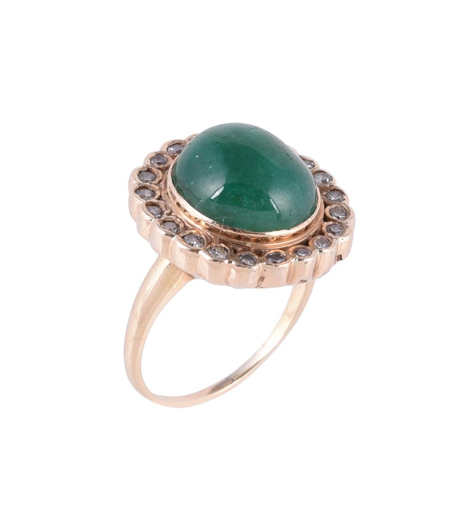 An emerald and diamond cluster dress ring