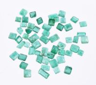 † A packet of step cut emeralds