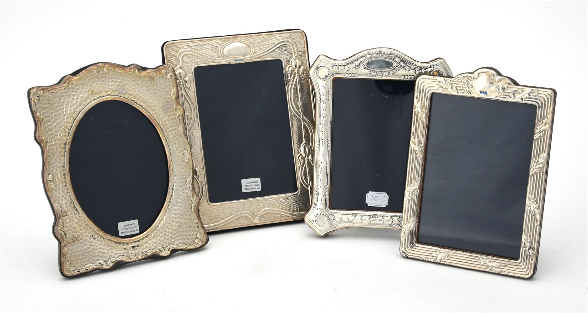 Four silver mounted photo frames by Ray Hall