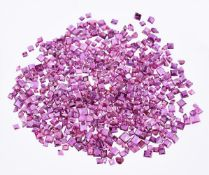 † A packet of unmounted step cut rubies