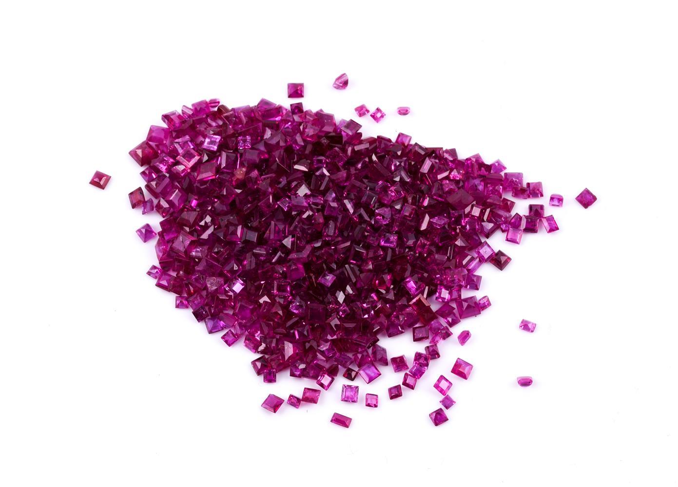 † A parcel of step cut rubies