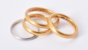 Two 22 carat gold band rings